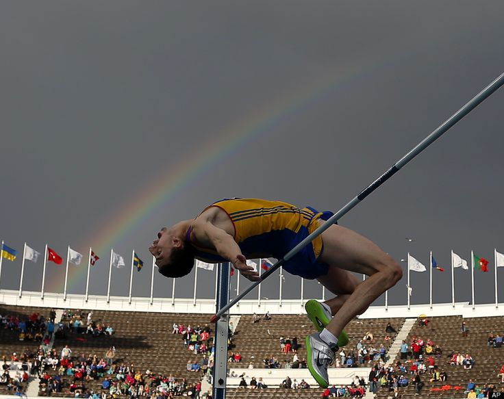 A rainbow is seen over a competitor in the Men's High Jump qualification at the European Athletics Championships in Helsinki, Finland, Wednesday, June 27, 2012. (AP Photo/Matt Dunham)
