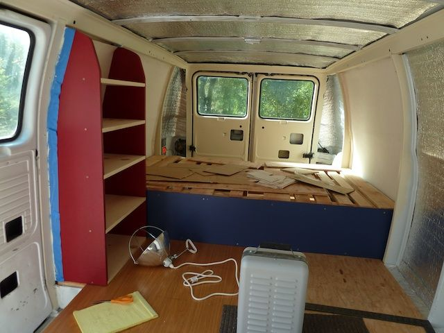 Bed at back with sliding mech coming forward. Cupboards up side of bed to maximise space.