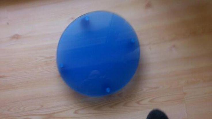 Maße: rund , Durchmesser 34 cm.
