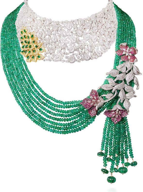 Zambian emerald, Mozambican ruby and diamond suit set in 18 carat yellow and white gold by Anmol Jewellers