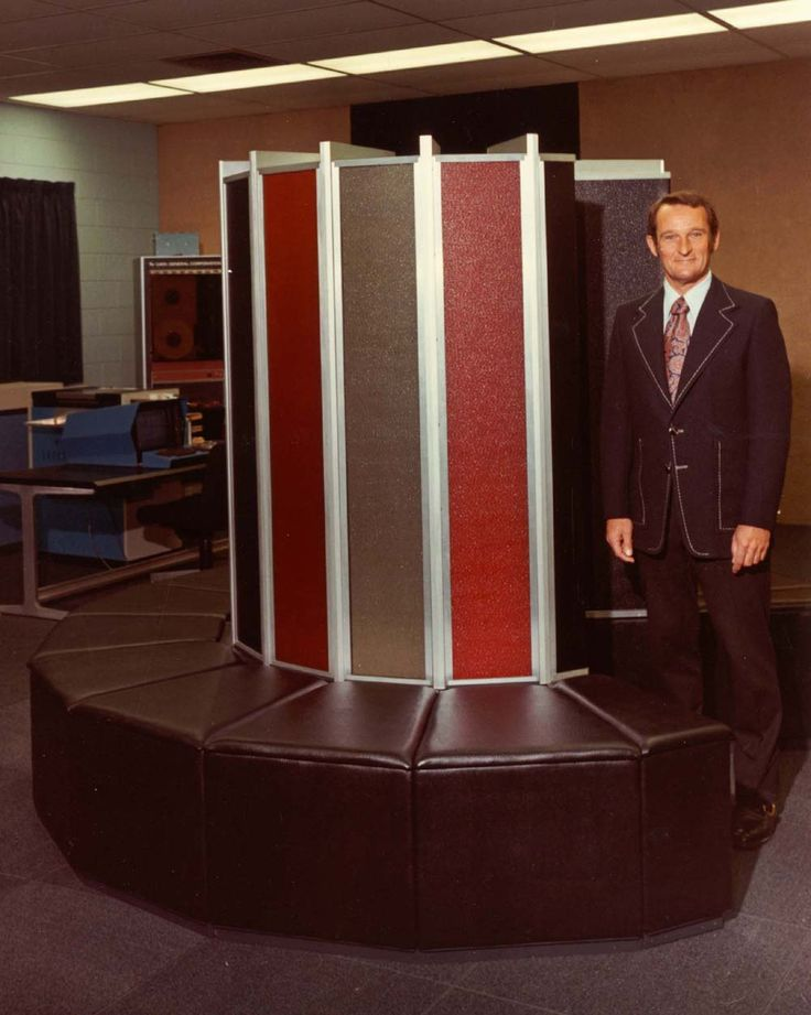 Seymour Cray standing next to the core unit of the Cray 1 computer, circa 1974