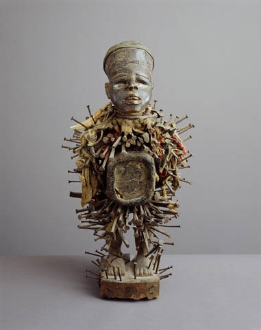 Kongo, Congo (Kinshasa)/Congo (Brazzaville)/Cabinda/Angola, 19th century  Wood, iron, cloth, mirror, leopard tooth, fiber, porcelain, 18 in. (45.7 cm) high  Charles B. Benenson Collection.