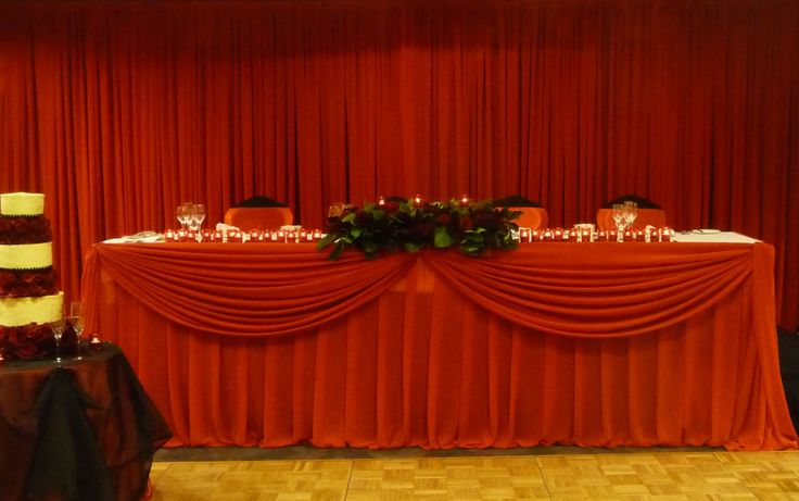 Bold red pleat and scalloped bridal table with red backdrop. Styled by Greenstone Events.