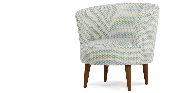 The Lulu Scoop Chair in honeycomb weave makes a comfortable and striking addition to your living room.