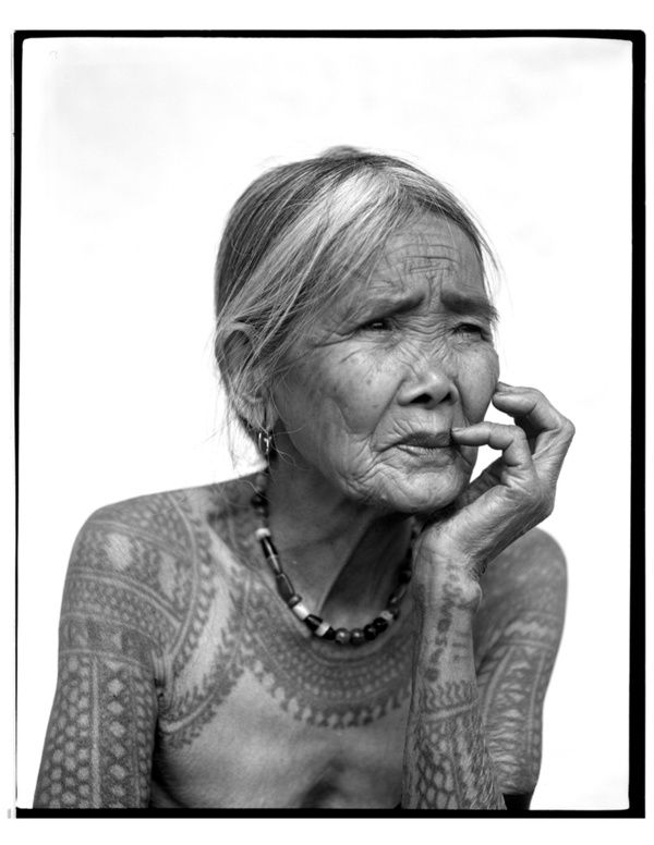 One of the last few women of Kalinga, from the Cordillera Mt Range of the Phillipines bearing the indigenous 'batok' or tattoo of their people.  The tattoos are not only a symbol of beauty and prestige, but they are also symbolic of the traditional values of women's strength and fortitude.  Sadly, this tradition is fading due to the changing perspective amongst the younger generation.