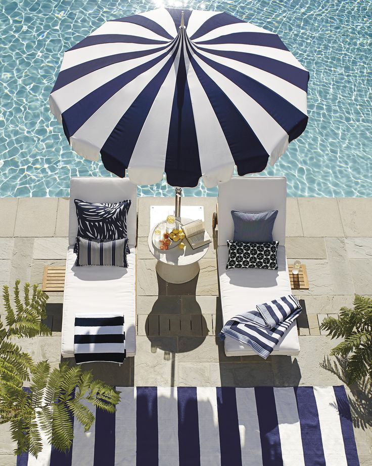 Relax poolside in our cushioned chaises with a striped beach umbrella and striped outdoor rug. Living Pool, Outdoor Living Areas, Outdoor Spaces, Outdoor Decor, Outdoor Daybed, Outdoor Cushions, Parasols, Patio Umbrellas, Sun Umbrella