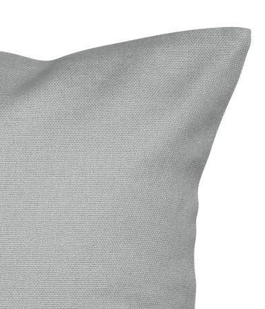 Een kussenhoes van katoenen canvas met een blinde ritssluiting.