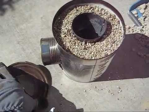 Rocket Wood Stove made from a #10 can, some soup cans, and vermiculite or sand for insulation. BRILLIANT.