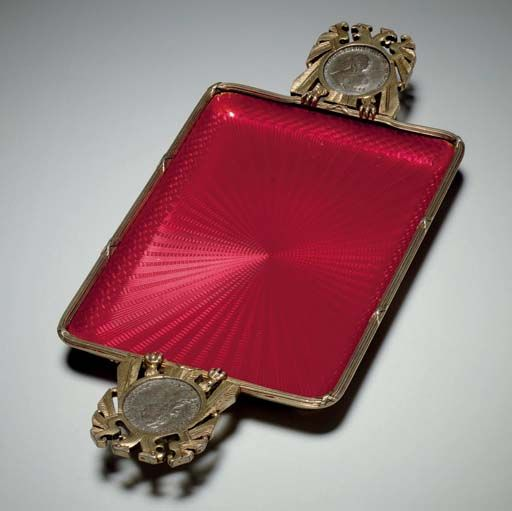 A Silver and Enamel Dish By Fabergé, workmaster's mark of Anders Nevalainen, St. Petersburg, 1896-1908, scratched inventory number 13224 Rectangular with rounded corners, enameled in strawberry red over a sunburst guilloché ground, with ribbon-tied reeded border, with handles at the sides in the form of double-headed eagles inset with silver coins dated 1754 and 1769, marked under handle.