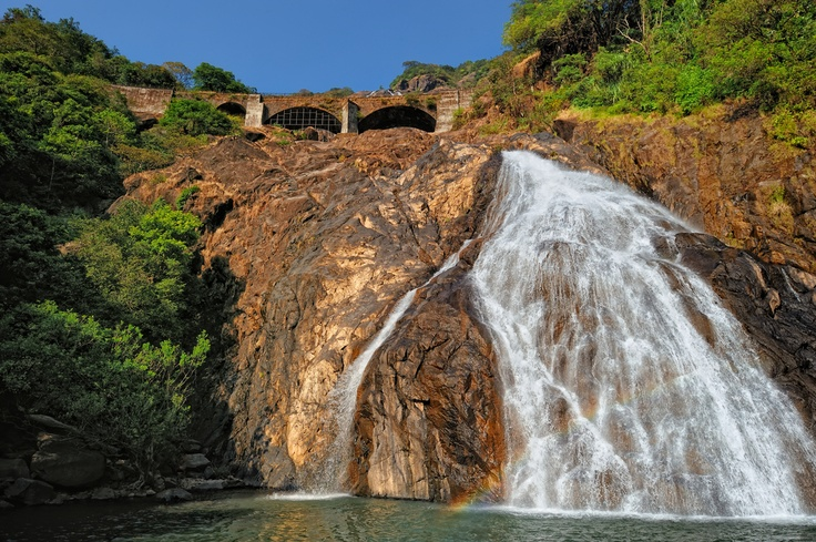 Tumbling down a mountainside, crossed over by an arched bridge along the South Central railway line, Dudhsagar falls is THE most impressive waterfall in Goa! #CoxandKings