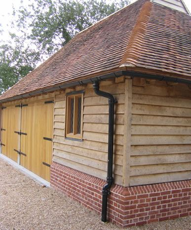Brick  flint plinth - oak frame - oak window  doors frames - weather boarding - wide eaves