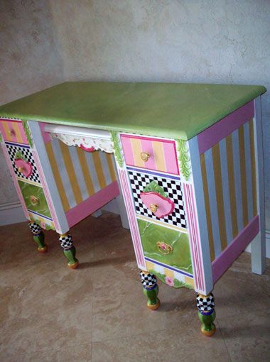 Hand painted desk. Nice color choices. And she painted it to be symmetrical, when she could have made a chaotic mess out of it. Nice job.