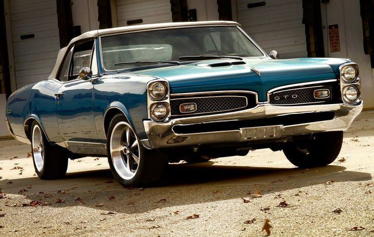 """PONTIAC GTO: circa 1967; a rare blue """"GOAT"""" with a black convert able with a 400 4bbl engine and a """"HURST dual gate"""" automatic shifter!"""