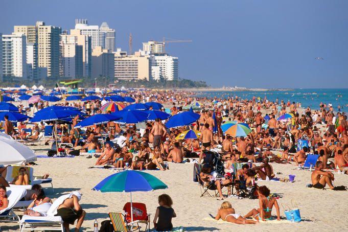 Crowds sunbathing on South Beach on New Year's Eve (Miami Beach, Florida)