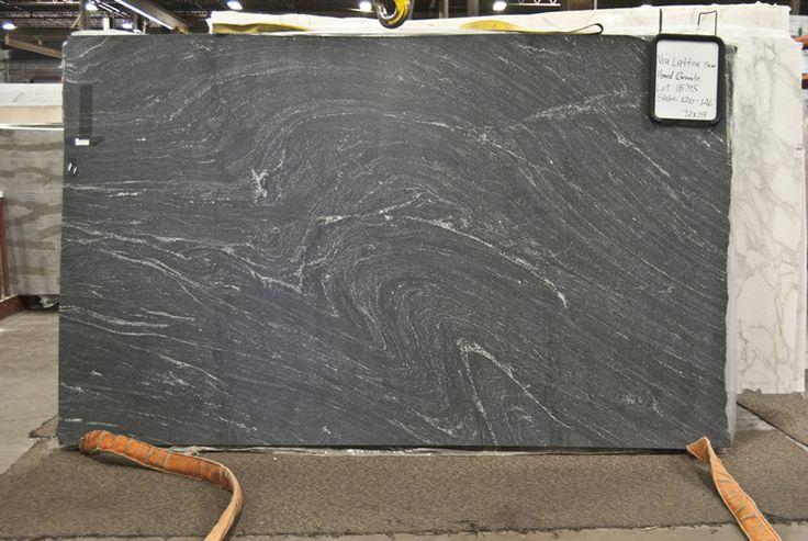 Ocean Black Honed Granit Countertops In White Kitchen