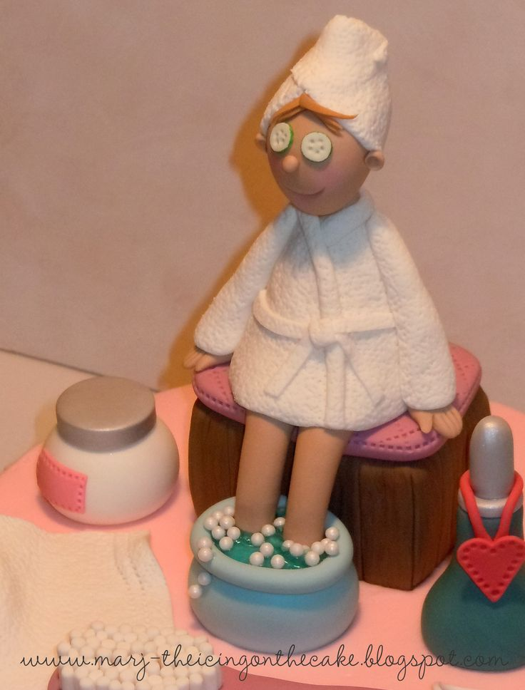 A Day at the Spa - Feet soaking in piping gel, eyes covered with gum paste cucumbers and a soft fondant terry robe - that's the way a cake decorator pampers herself!  Hee hee!