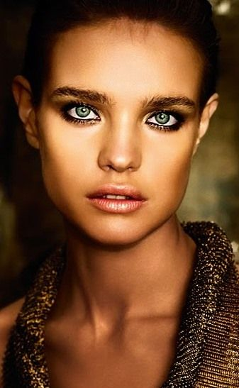 The almost unnatural tan skin enhances the aquatic-tinted outlined eyes. Enhancing and eye-opening photography.