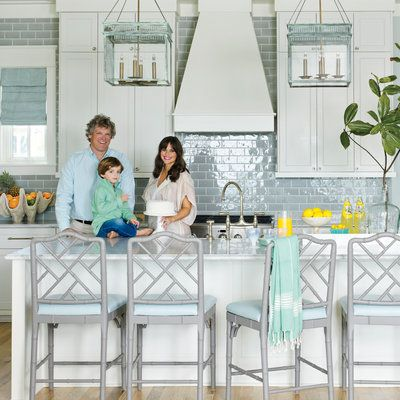 In a light-filled kitchen, extra glossy subway tiles are the way to go.