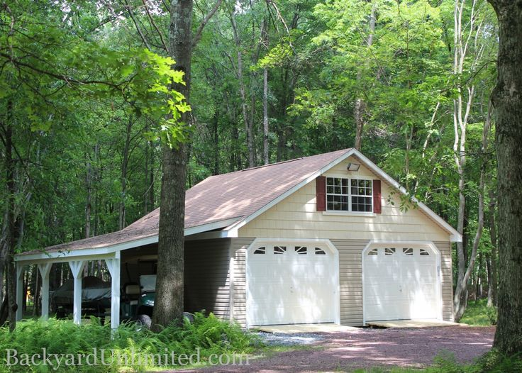 24'x24' Two Story Garage with Cape Cod dormers, metal roof, Heritage garage doors on eave side and ramp