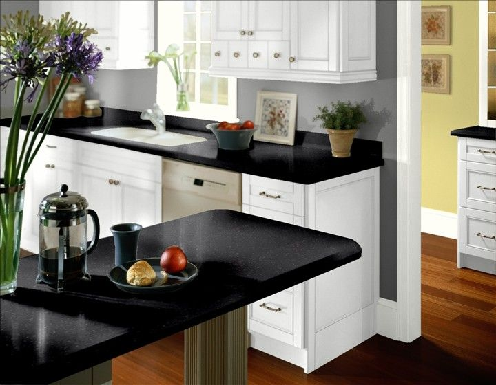 Kitchen Design : Indoor Plants Wooden Floor White Cabinets Grey Walls  Kitchen With Black Marble Table ~ HeimDecor