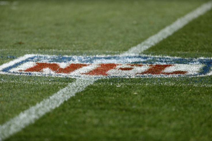The NFL logo adorns the field in during the first half of an NFL football game between the Denver Broncos and the Dallas Cowboys, Sunday, Sept. 17, 2017, in Denver. (AP Photo/Jack Dempsey)