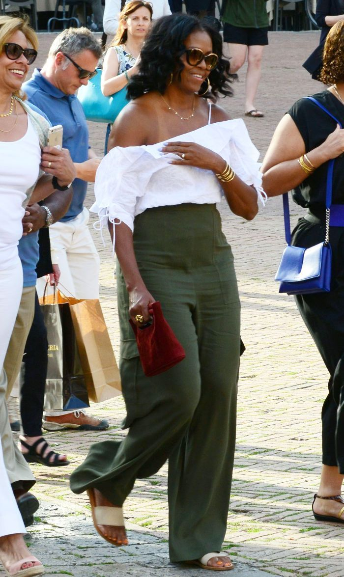 Michelle Obama was spotted in Tuscany, Italy, wearing a top from a mall brand you may have forgotten about—shop it here.