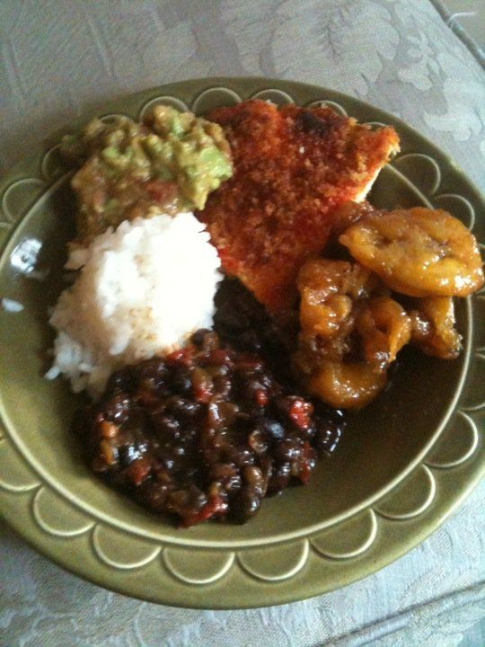 Chicken Milanesa; Cuban style with rice and black beans, fried maduros (sweet plantains), and some mashed avocado with salsa mixed in.