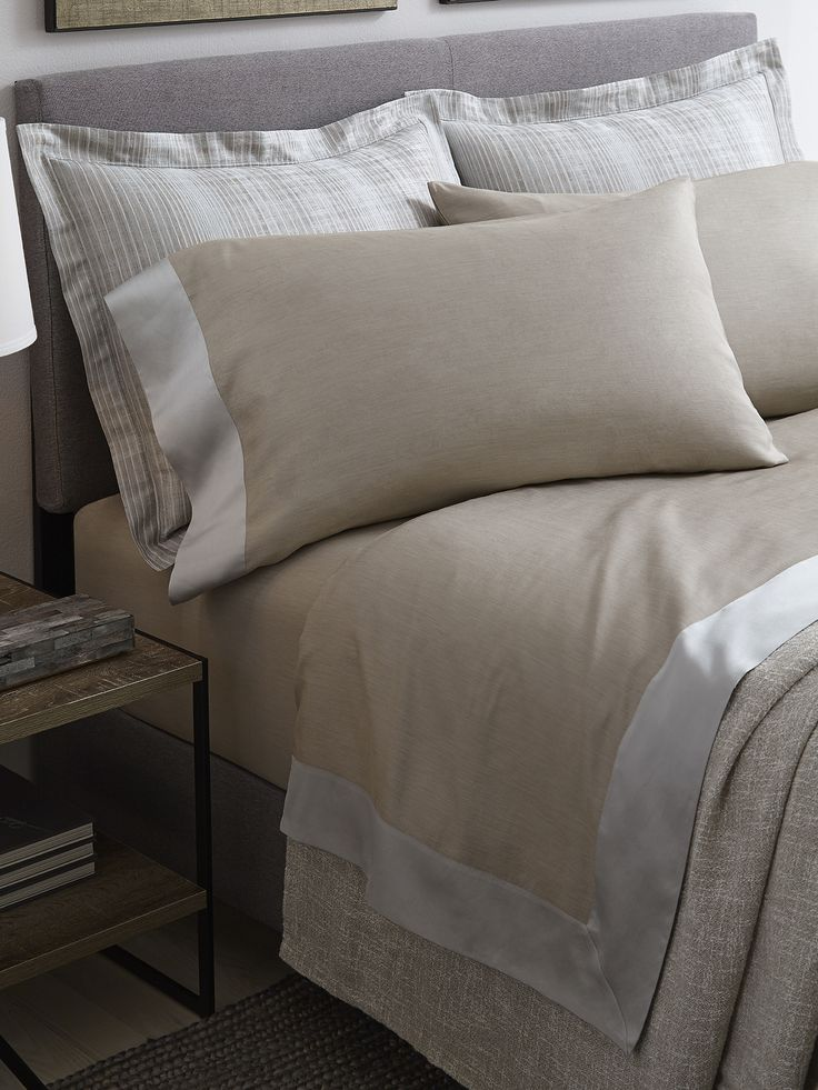 Larro's double-faced sheeting has as luscious a hue and sleek hand on the reverse as it does its front. It comes in two color options—one with a tonal nougat cuff and the other with a blue/grey contrast—for contemporary styling at its best.