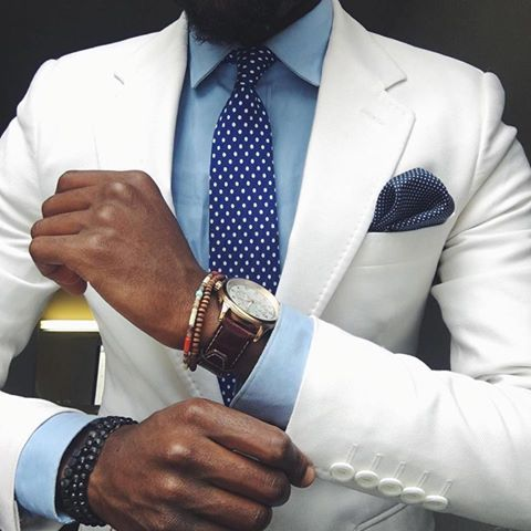 white suit with colored shirt  5 buttons on suit jacket. slim cut sharp i like the top stitching on the collar