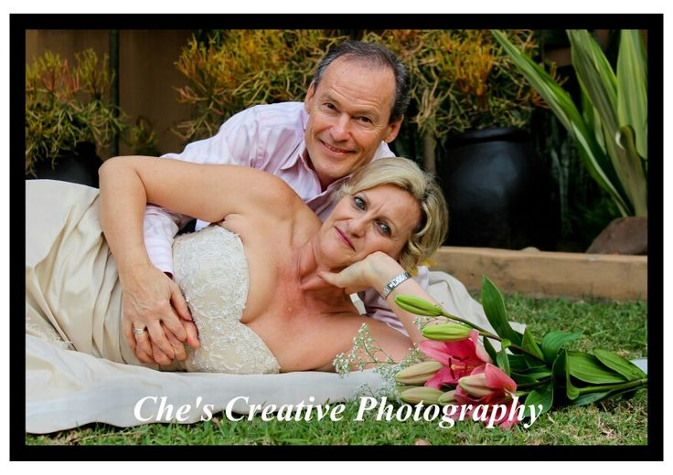 Married couple photography lying down flowers