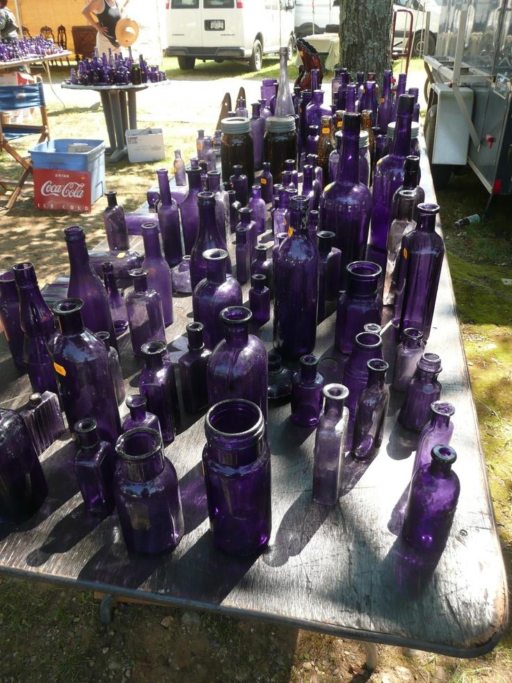 antique purple glass bottles....