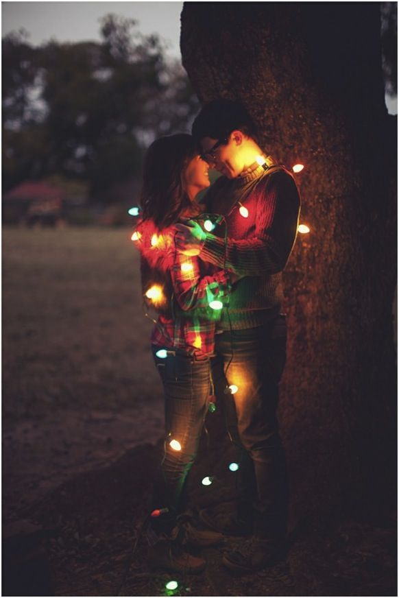 Strands of lights are a beautiful addition to a nighttime engagement shoot