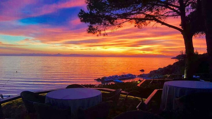 Enjoy the most spectacular sunset along with a glass of wine at Ithaki Restaurant beautiful terrace.