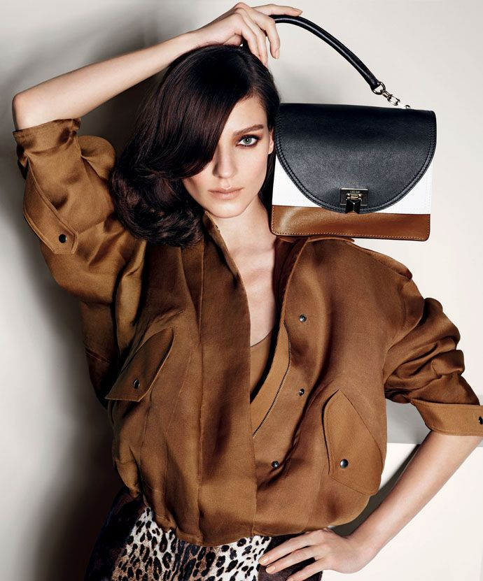 The bottom of the handbag blends in with the shirt while the top blends with her hair. The white middle blends in with the background, creating an interesting layout.  Smile: Ad Campaign: Max Mara Spring 2013: Kati Nescher by Mario Sorrenti