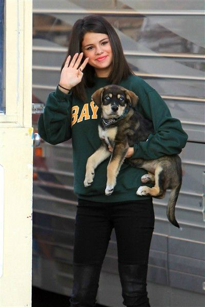 Selena Gomez and her dog Baylor, who was adopted from an animal rescue center in Canada. #celebrities #dogs