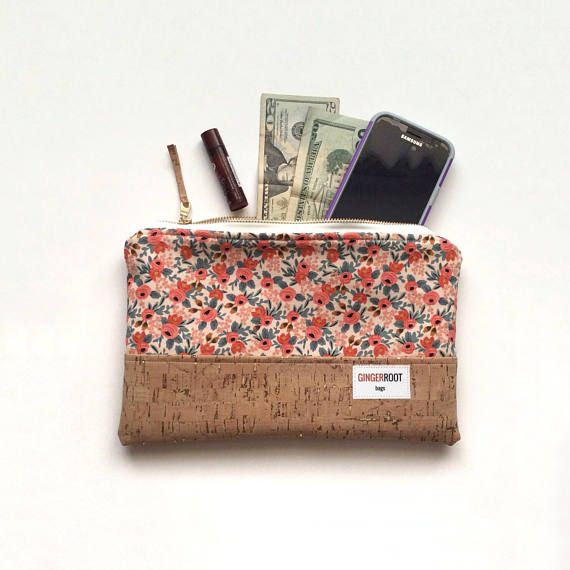 Ginger Root Bags cork clutch. This clutch is perfect for everything from everyday use to a girls' night out! It's a stunning accessory to pair with any outfit, and it's the perfect size to hold all of your things.