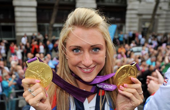 Laura Trott Photos - British Olympic gold medal winning cyclist Laura Trott shows her gold medals during the London 2012 Victory…
