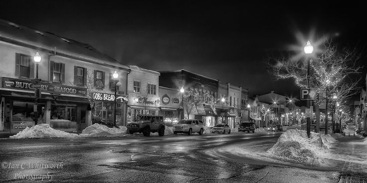 A snowy downtown Oakville night scene in black and white.