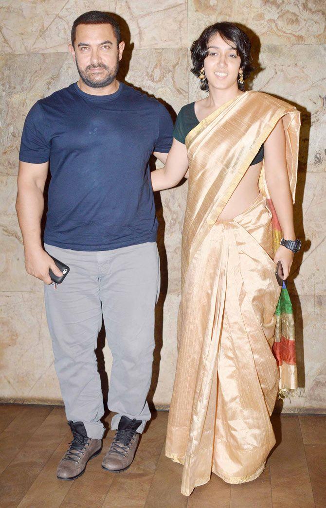 Aamir Khan and daughter Ira Khan at 'Bajrangi Bhaijaan' screening. #Bollywood #BajrangiBhaijaan #Fashion #Style #Beauty #Handsome