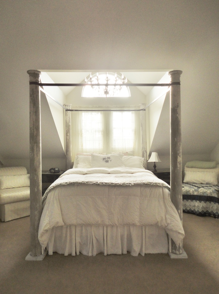 Re-purposed porch post 4 poster canopy bed