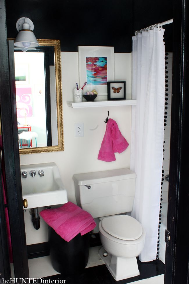 From The Hunted Interior Black And White Striped Floor Pom Trim On Shower Curtain Gold Mirror Pop Of Pink Bathroom Pinterest