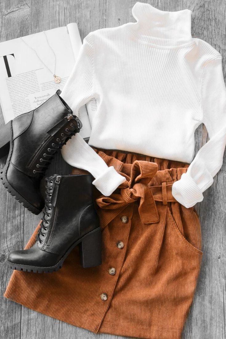 Super cute women's tan corduroy skirt with a tie belt and buttons down the front! Paired with the best selling Charleston Turtleneck and Edge of Life …