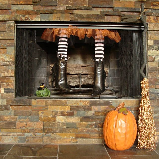 Though not technically a mantel, we had to include this cute DIY fireplace craft. Mother and daughter bloggers Jeanette and Leigh of Crafty in Crosby created this pair of witch legs out of old boots, a pool noodle, and Halloween tights.
