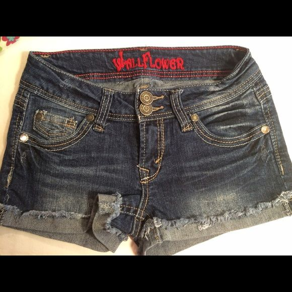 """Denim shorts by Wallflower, Juniors size 3 These juniors Wallflower rolled frayed cuff denim shorts will turn heads!   5 pocket styling with embroidered back pockets.  Approx 2.5"""" inseam.  Low rise with 2 button and zipper fly.  Excellent condition. #wallflower #denim #jeanshorts Wallflower Jeans"""