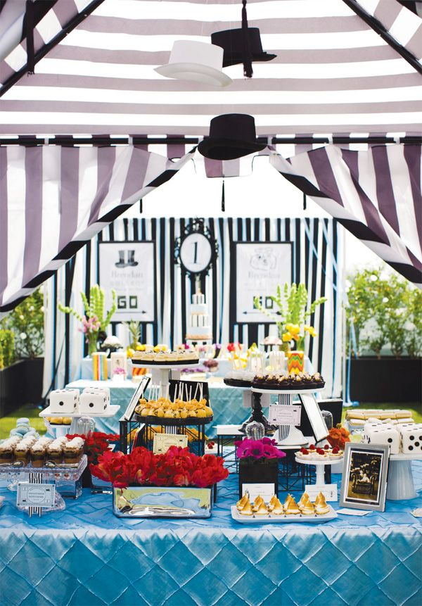 floating hats + Monopoly themed dessert table