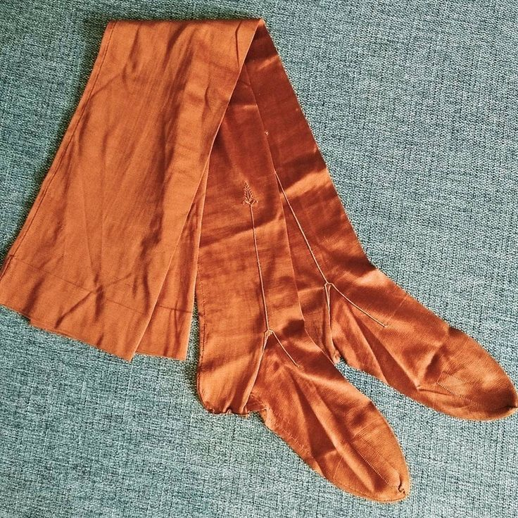 Silk stockings in a lovley copper colour with hand embroidery. 1920s or older