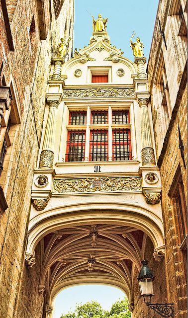 The beautiful archway over Blinde Ezelstraat (Blind Donkey Street) in Bruges, Belgium by Anguskirk