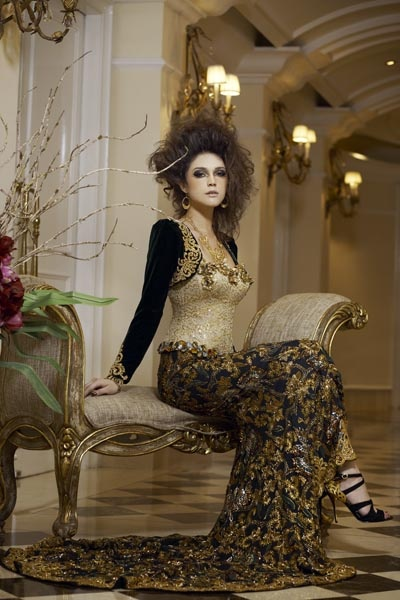Three-piece couture kebaya with velvet bolero, gold sequined bustier and metre-long mermaid skirt by Amy Atmanto. Gold earrings and necklace by SWARNA Heritage Accessories. Ankle-high strappy shoes with gold heels by Pedro.