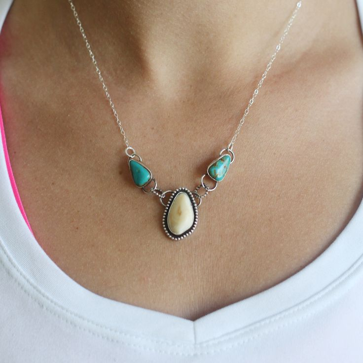 Sterling Silver Elk Ivory Necklace Features Pilot mountain turquoise Measures 18inches from end to end