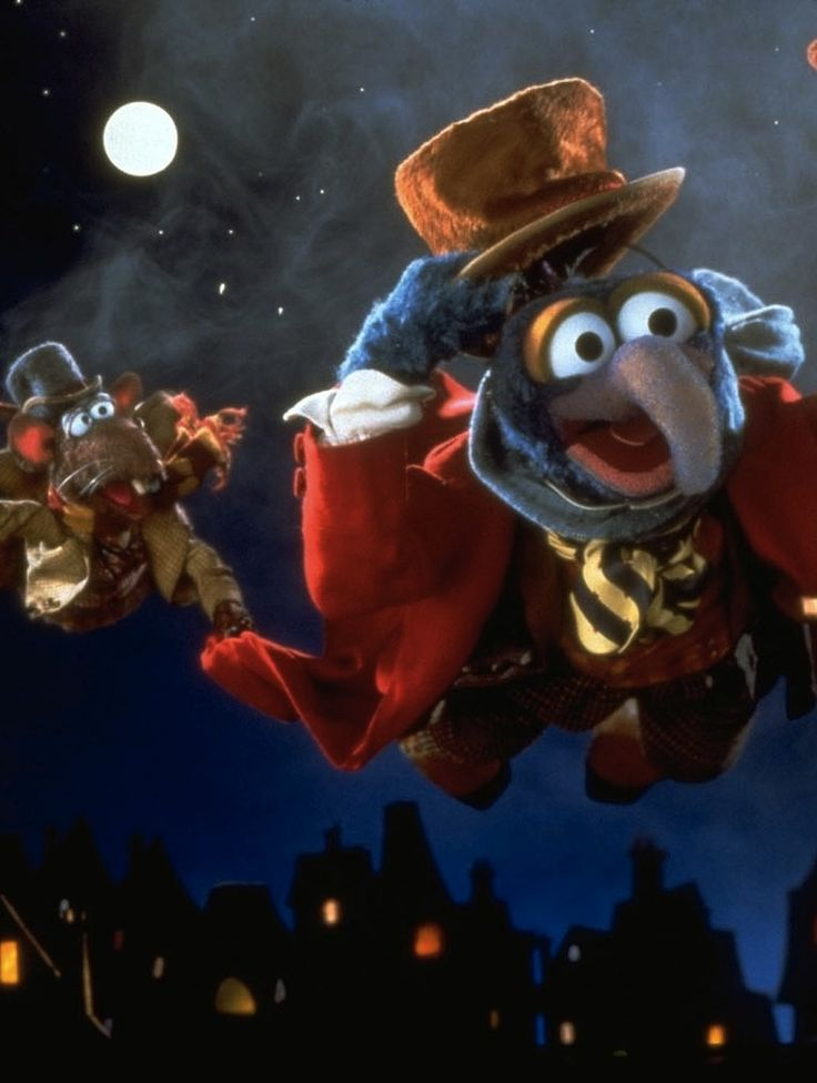 The Muppets Christmas Carol, 1992. The Great Gonzo as Charles Dickens & Rizzo the rat as himself. Rizzo is here for the food.